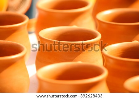 Disposable clay cups in a row