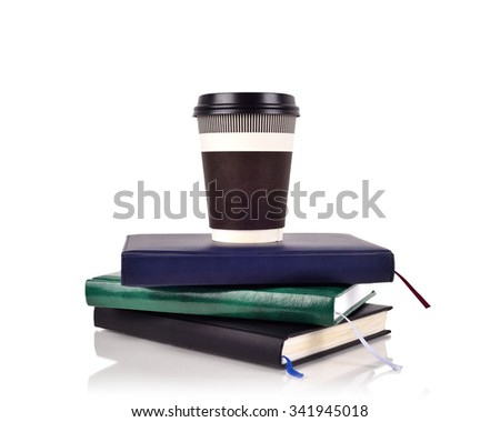 disposable coffee cup on books, close up - stock photo