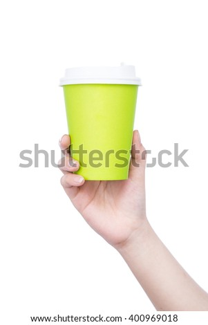 disposable cup of coffee in hand isolated on white background. Advertising coffee with copyspace