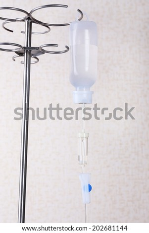 Disposable infusion set on wall background - stock photo