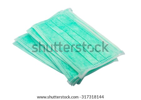 Disposable medical face masks closeup isolated on white background - stock photo