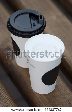 disposable paper cup of coffee