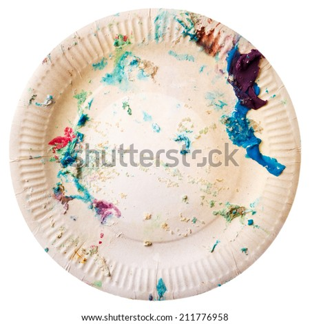 Disposable paper plate with cake crumbs isolated on white background. End of birthday party concept. - stock photo