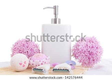 disposable razors, soap and flowers over white - stock photo