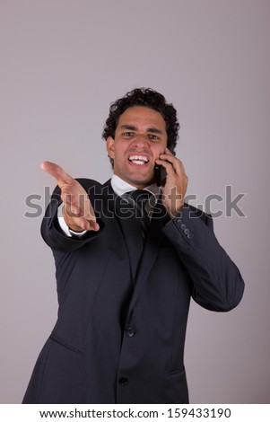dissatisfied businessman while he talking on mobile - stock photo