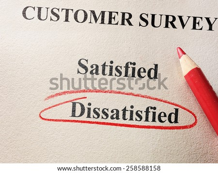 Dissatisfied circled in red circle on customer survey                               - stock photo