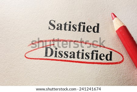 Dissatisfied circled in red circle on textured paper                                - stock photo