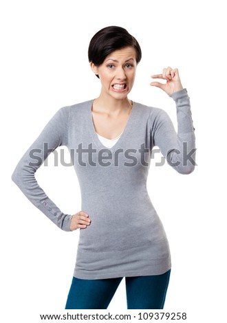 Dissatisfied woman gestures small amount, isolated on white - stock photo