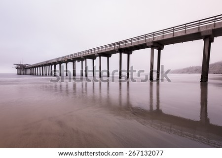 Distance landscape of a boat dock and low tide beach