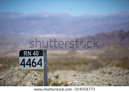 Distance Sign road on gravel road on the famous Ruta 40 (Route 40) within Calchaqui Valleys in Salta Province. Argentina