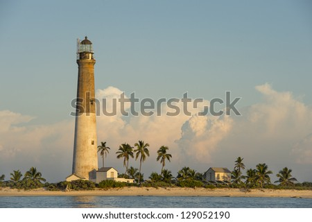 Distance view of a Dry Tortugas Light on sunset - stock photo
