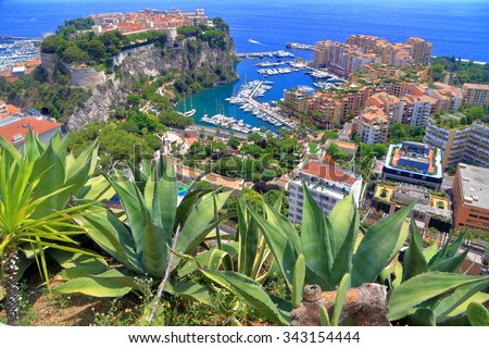 Distant buildings and marina of Monaco seen from the nearby hills, Monaco - stock photo
