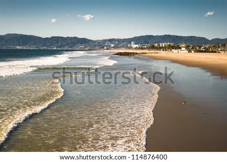 Distant buildings skirt the Venice Beach California skyline. - stock photo