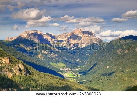 Distant clouds above summits and valleys of the Dolomite Alps, Italy