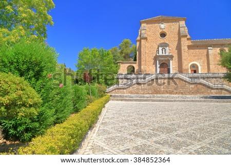 Distant facade of the Baroque building of the Granada Charterhouse (Cartuja monastery) in Granada, Andalusia, Spain - stock photo