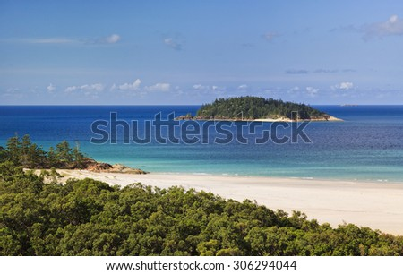 distant island from Whitsunday island whiteheaven beach. White silica sandy beach and pristine clean water form idyllic national park in Coral sea of Great Barrier reef in Australia - stock photo