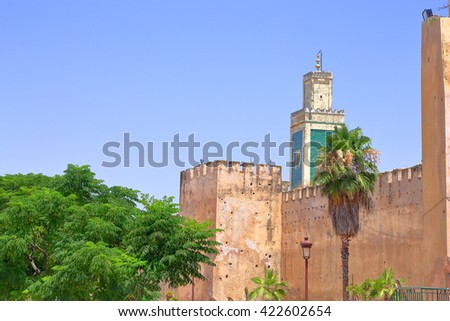 Distant minaret above the medieval walls of the Medina of Meknes, Morocco