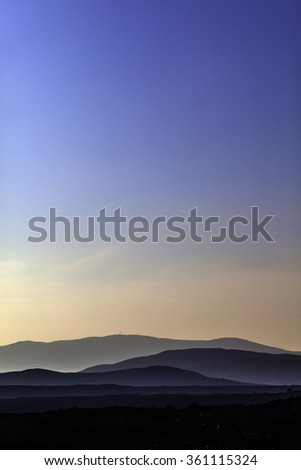 Distant mountains in the highlands of south Iceland on a warm day late summer - stock photo