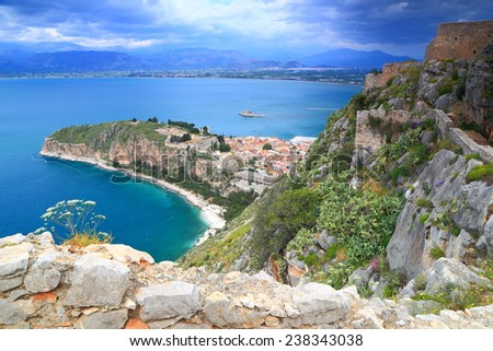 Distant town and harbor surrounded by Mediterranean sea, Nafplio, Greece