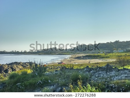 Distant view at the beach located in a poor zone in the atlantic river coast in the city of Montevideo, Uruguay in South America - stock photo