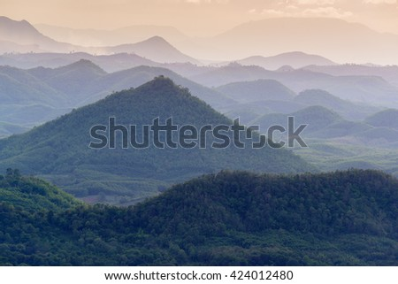 Distant view of mountain range in the evening. Background for montage purpose. - stock photo