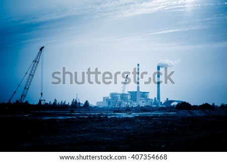distant view of oil refinery factory - stock photo