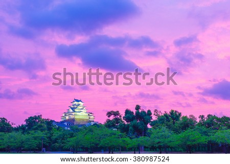 Distant view of the newly restored Himeji-jo castle with wide open, colorful, purple sky during a summer evening in Himeji, Japan after renovations in 2015. Horizontal copy space