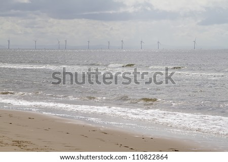 Distant view of wind turbines from Formby beach, Liverpool - stock photo