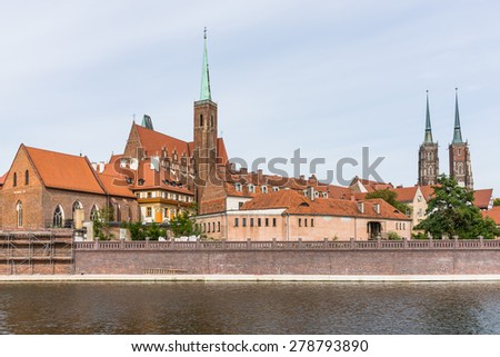 Distant view on  the Ostrow Tumski, district of Wroclaw, Poland, the oldest part of the city, with The Cathedral of St. John the Baptist and the Church of the Holy Cross. - stock photo