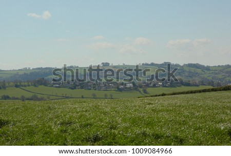 Distant village in rolling countryside