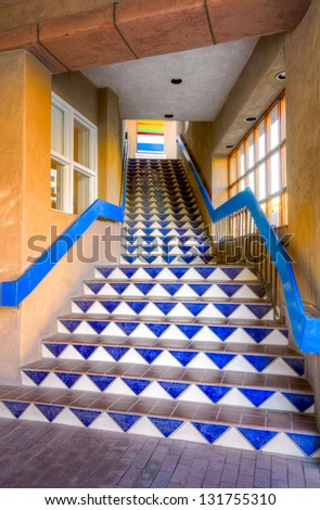 Distinctive blue tile mosaic stairwell in downtown Santa Fe, New Mexico - stock photo