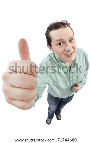 Distorted image of a cheerful young man gesturing OK sign. Fish-eye lens used. Studio shot. Isolated on pure white background.