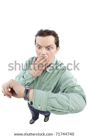 Distorted image of a man checking the time and being late. Fish eye lens used. Studio shot. Isolated on pure white background. - stock photo