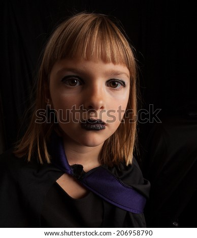Distorted wide angle close up of a girl dressed as a vampire for Halloween - stock photo