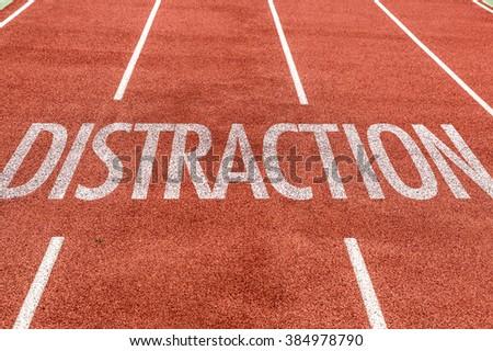 Distraction written on running track - stock photo