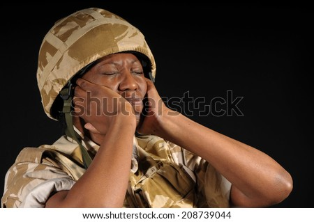 Distraught Female Soldier - stock photo