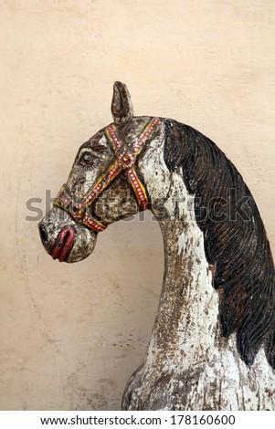 Distressed old wooden horse - stock photo