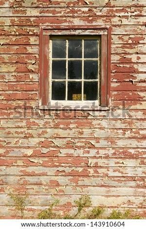 Distressed red barn side and window in Acadia National Park, Maine - stock photo
