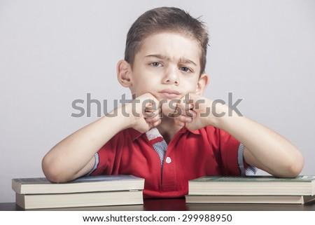 Distressed school boy - stock photo
