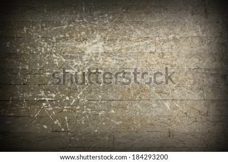 distressed stone masonry wall, scratched architectural ancient style backdrop - stock photo