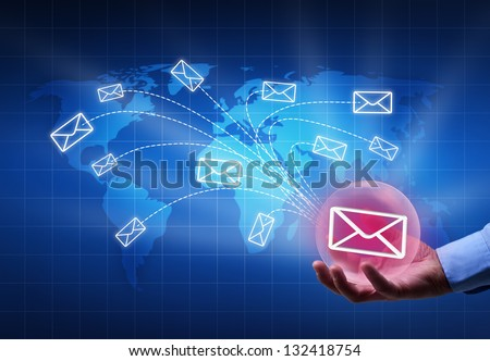 Distributing information in a digital world concept - bubble radiating mail envelopes - stock photo