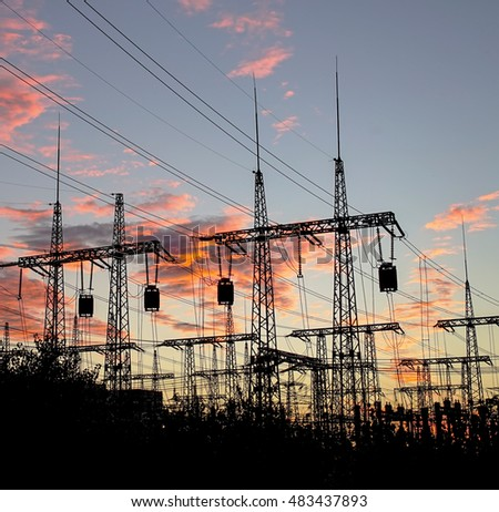 distribution electric substation pylon with lines, at sunset