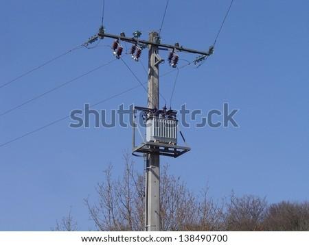 Distribution transformer on pole - stock photo