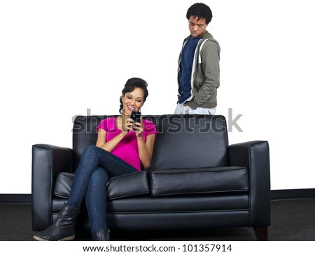 distrusting couple snooping on cell phone text messages - stock photo