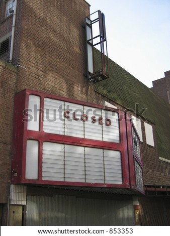 Disused cinema, with dilapidated old style signage 'CLOSED'