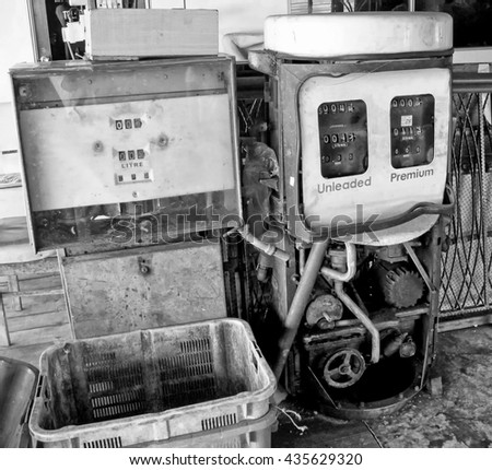 Disused vintage gas pump, processed in monochrome.  - stock photo