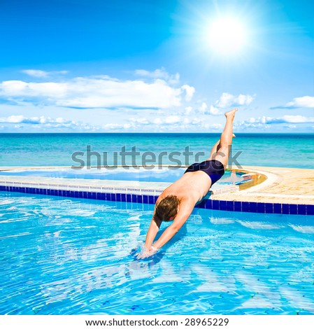 Dive into pool - stock photo
