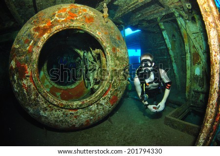 Diver and the recompression chamber, USS Kittiwake, Grand Cayman - stock photo