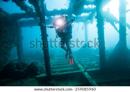diver explorer the wreck underwater - stock photo