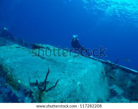 diver explores a wreck - stock photo